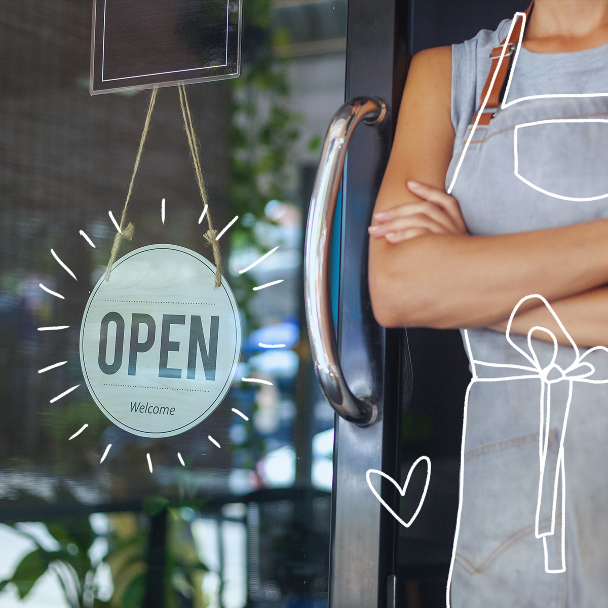 woman standing in front of her business with open sign learn how to protect your business from cyber attacks with these tips