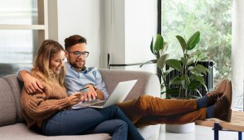 Couple looking at the computer during annual insurance review