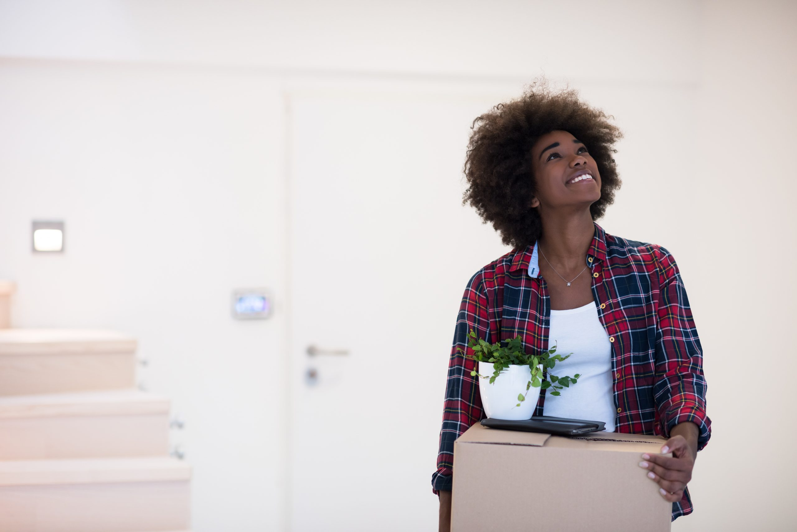 Young woman moving into home