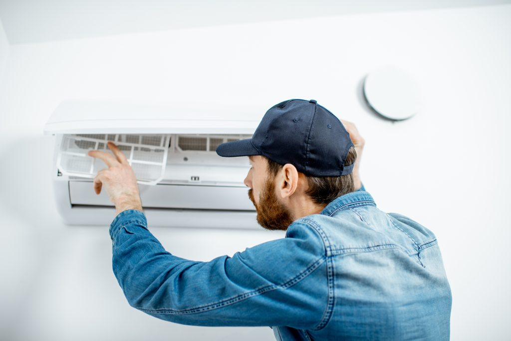 Man serving the air conditioner