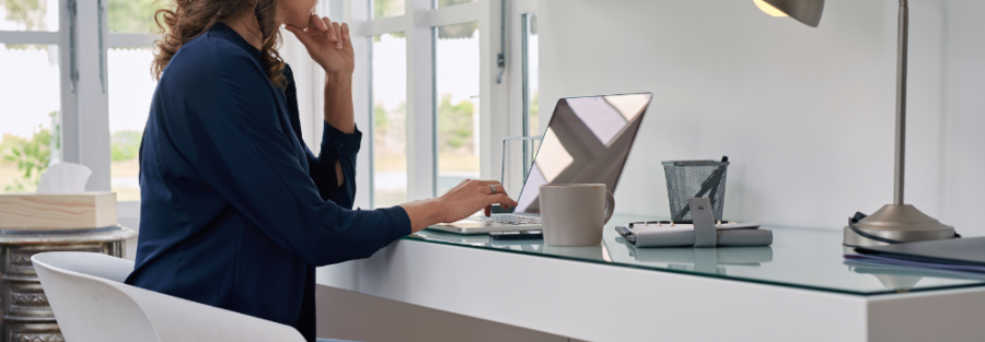 Woman working on computer at home