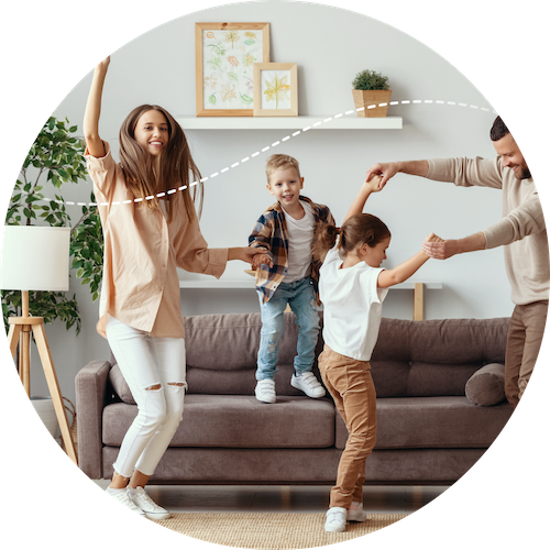 Family dancing around couch in a living room