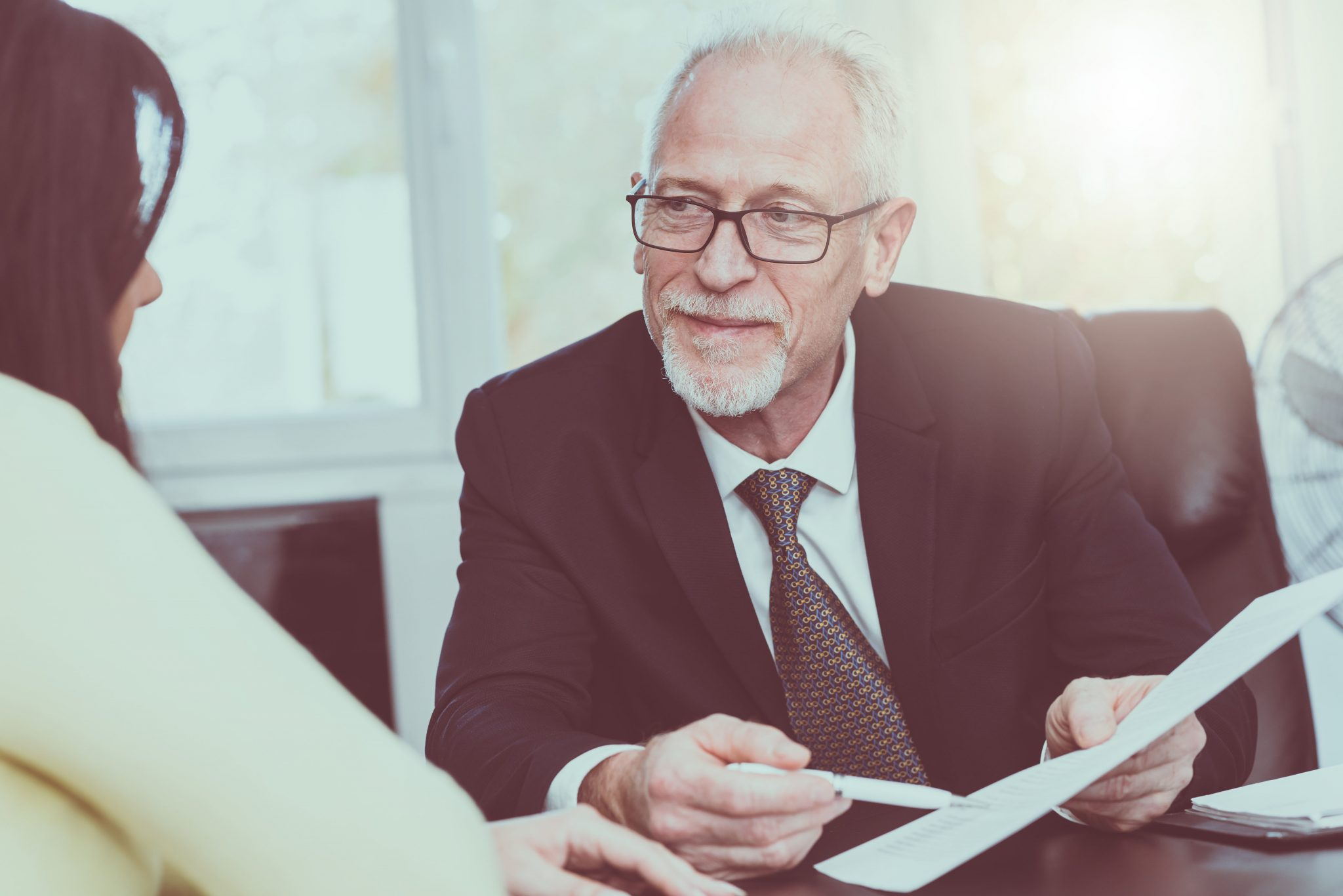 Life insurance Advisor reviewing policy with client